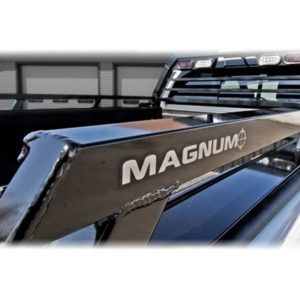 "A closeup of a Magnum Bed Rail System rail with the words ""Magnum"" painted on."