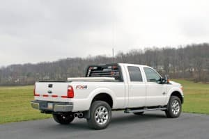 A white Ford F-350 with a truck rack.