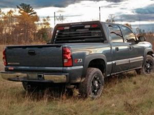 A chevrolet silverado with a magnum low pro truck rack