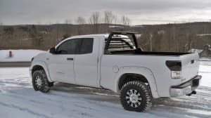 A white Toyota Tundra with a Magnum Low Pro Truck Rack