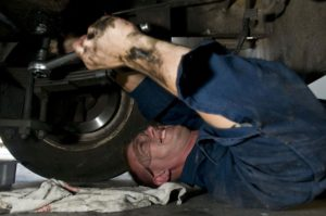 Navy mechanic changing oil