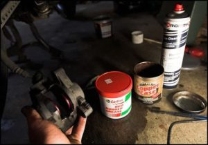 Red Rubber grease in a workshop
