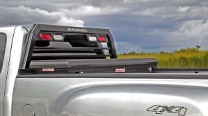 A 2013 GMC Sierra 3500 with a Magnum truck rack and Weather Guard tool box