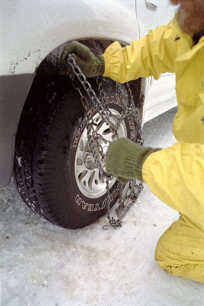 Chains Being Put on Tires
