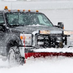 Plow truck plowing snow